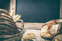 Freshly baked bread in wicker basket with copyspace Stock Photo