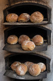 Freshly baked bread in a wood-fired stone oven Royalty Free Stock Images