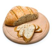 Freshly baked bread on wooden cutting board isolated on white background Royalty Free Stock Image
