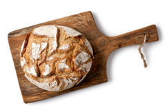 Freshly baked bread. On wooden cutting board isolated on white background, top view stock photography
