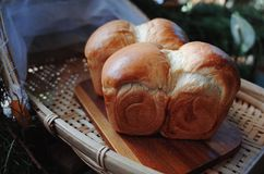 Freshly baked bread on wooden table Stock Images