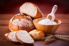 Freshly baked bread. On wooden table Royalty Free Stock Image