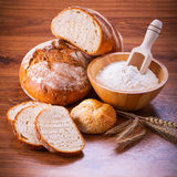 Freshly baked bread. On wooden table Stock Images