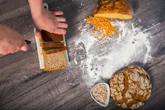 Freshly baked bread on wooden table Stock Image