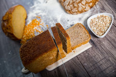 Freshly baked bread on wooden table Royalty Free Stock Images