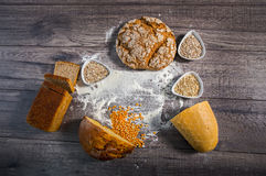 Freshly baked bread on wooden table Stock Photos
