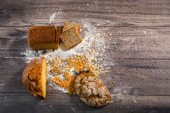 Freshly baked bread on wooden table Royalty Free Stock Photography