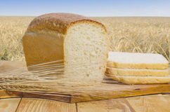 Freshly baked bread on a wooden table outdoors stock photos