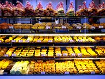 Freshly baked breads and pastries on display at a bakery store in the town of Tampines in Singapore Royalty Free Stock Image