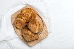 Freshly baked buns with almonds. Croissants. Freshly baked buns with almonds.Croissants.On marble table Stock Photos
