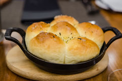Freshly baked buns in an ironcast pan Royalty Free Stock Photos