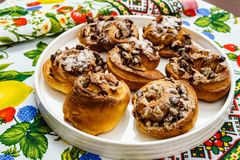 Freshly baked buns with nuts on colored towel top view. royalty free stock image