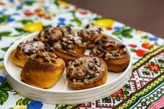 Freshly baked buns with nuts on colored towel top view. stock photo