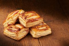 Freshly baked buns on wooden cutting board, close-up.  royalty free stock photography