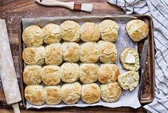 Buttermilk Southern Biscuits in Baking Pan. Freshly baked buttermilk southern biscuits or scones from scratch with rolling pin and basting brush on a baking royalty free stock image