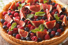 Freshly baked cake with fresh figs, raspberries and blueberries Stock Photos