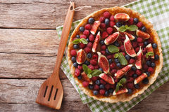 Freshly baked cake with fresh figs, raspberries and blueberries. Stock Image