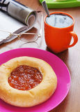 Freshly baked cake with jam and cup of black tea Royalty Free Stock Photography