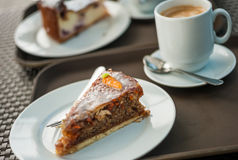 Freshly baked carrot cake with a cup of hot coffee Royalty Free Stock Photo
