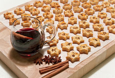 Freshly Baked Cheese Cookies And Hot Wine Stock Photos