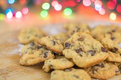 Freshly baked chocolate chip cookies closeup on wooden board Royalty Free Stock Photography