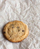 Freshly baked chocolate chip cookies. On paper stock images