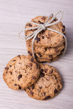 Freshly baked chocolate chip cookies on wooden background Royalty Free Stock Images