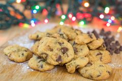 Freshly baked chocolate chip cookies on wooden board Stock Photography
