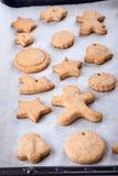 Gingerbread cookies on a baking sheet stock photos