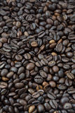 Coffee Beans Background. Freshly baked coffee beans covering the whole frame Royalty Free Stock Photos