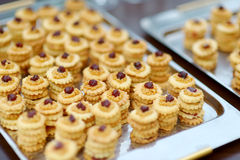Freshly baked cookies on cooling rack Stock Photography