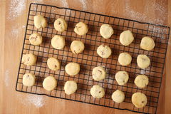 Freshly baked cookies on a tray served on kitchen table Royalty Free Stock Photography