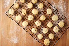 Freshly baked cookies on a tray served on kitchen table Royalty Free Stock Photo