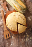 Freshly baked corn bread close-up on a wooden board. Vertical to Royalty Free Stock Photo