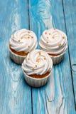 Freshly baked cream cupcake stock photo