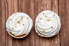 Freshly baked cream cupcake stock images