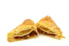 Freshly baked crispy apple turnover halves stock photos