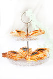 Freshly baked croissant. Freshly baked flaky croissant with poppy in a tow-level vase Royalty Free Stock Photography