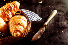Freshly Baked Croissant and Cutting Knife on Table Royalty Free Stock Photos