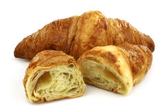 Freshly baked croissant and two halves Stock Photos