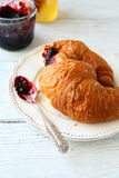 Freshly baked croissant on a white plate Stock Photography