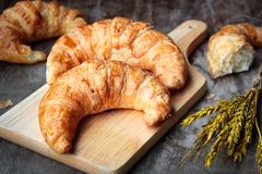 Freshly Baked Croissants On Wooden Cutting Board Stock Image