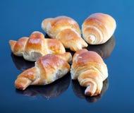 Freshly baked croissants on plate for breakfast Stock Photo