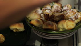 Freshly baked croissants on a plate in a home kitchen. Sweets and bread for breakfast in the morning sun. High quality footage - original size 4k 3840x2160 stock footage