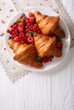 Freshly baked croissants with raspberries, blueberries and curra Stock Image