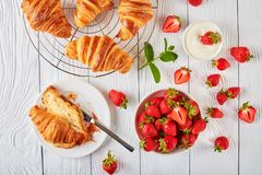 Freshly baked croissants with ripe berries Stock Image