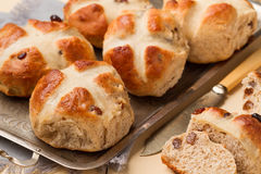 Freshly baked cross buns on a metal tray stock photography