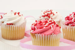 Freshly Baked Cupcake. With Pink And White Frosting Royalty Free Stock Images