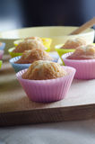 Freshly Baked Cupcakes Cooling on Wooden Chopping Board Royalty Free Stock Image