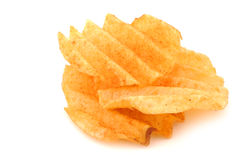 Freshly baked deep ridged potato chips. On a white background Royalty Free Stock Images